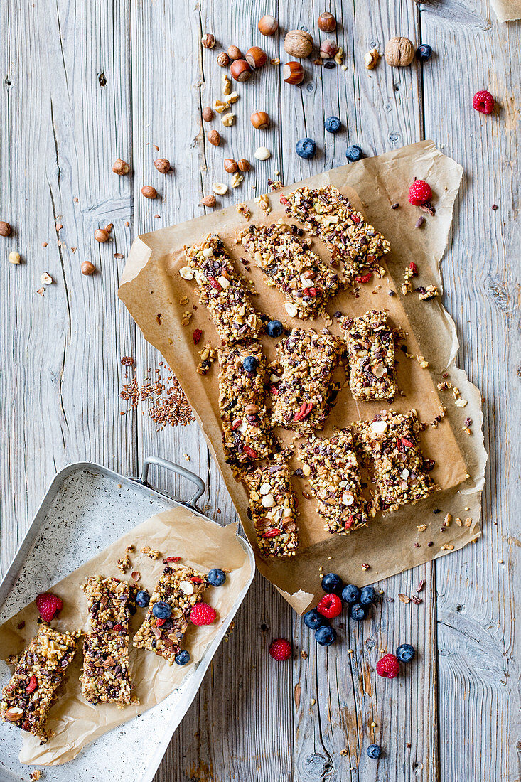 Homemade granola bars with nuts, kernels and berries