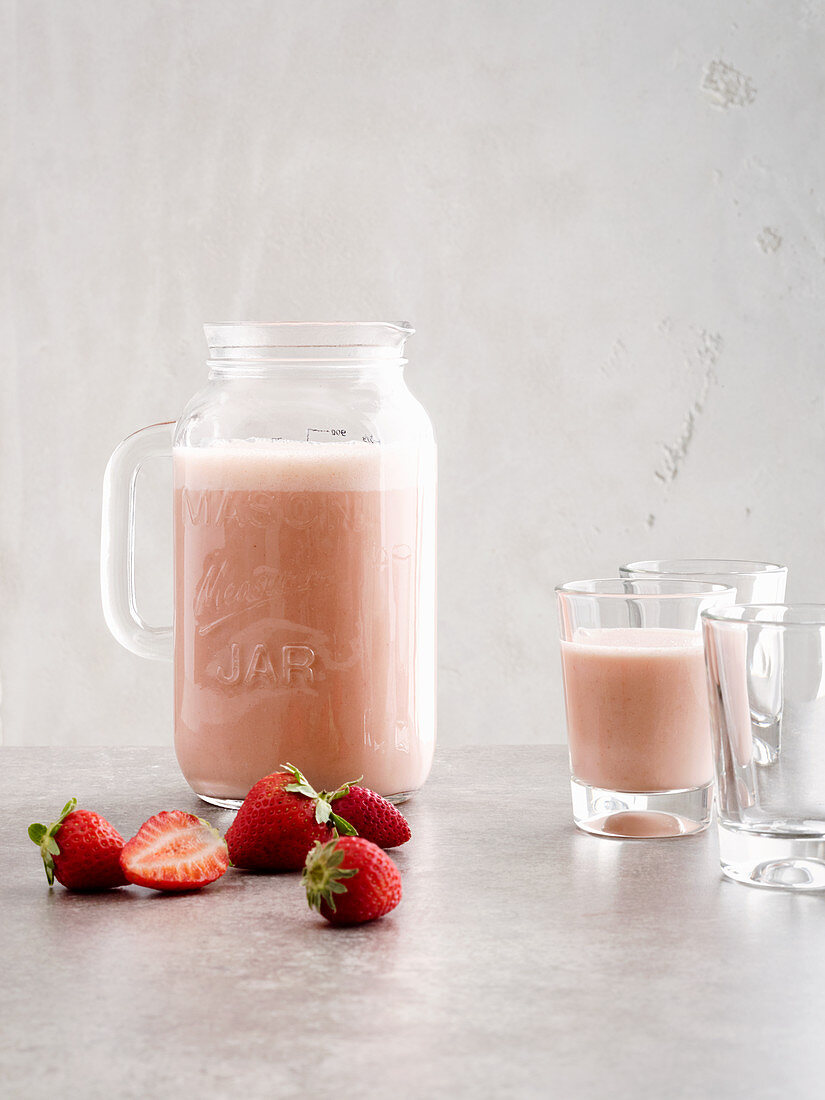 Pink grapefruit smoothie made with strawberries and yoghurt