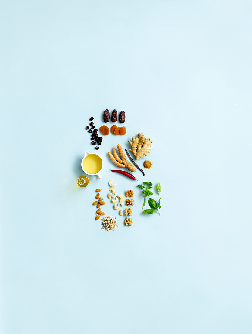 An arrangement of spices, herbs, nuts, oils and dried fruits