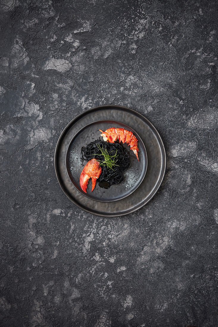 Lobster with black noodles