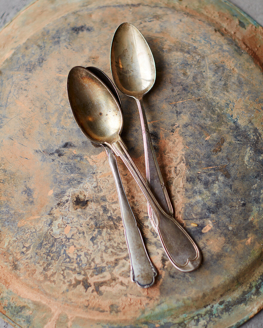 Antique spoons on a plate