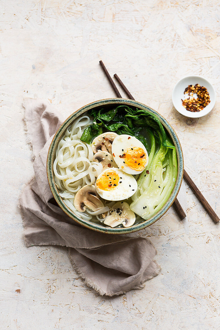 Miso rice noodle bowl with pak choi, eggs and mushrooms