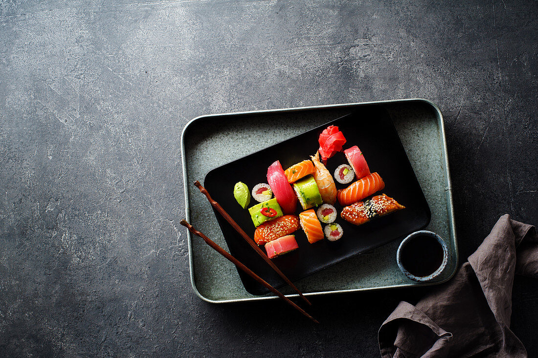 Variety of sushi and rolls served on a plate