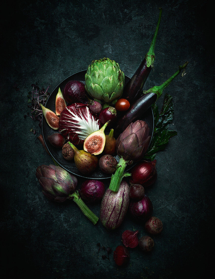 An arrangement of purple fruits and vegetables