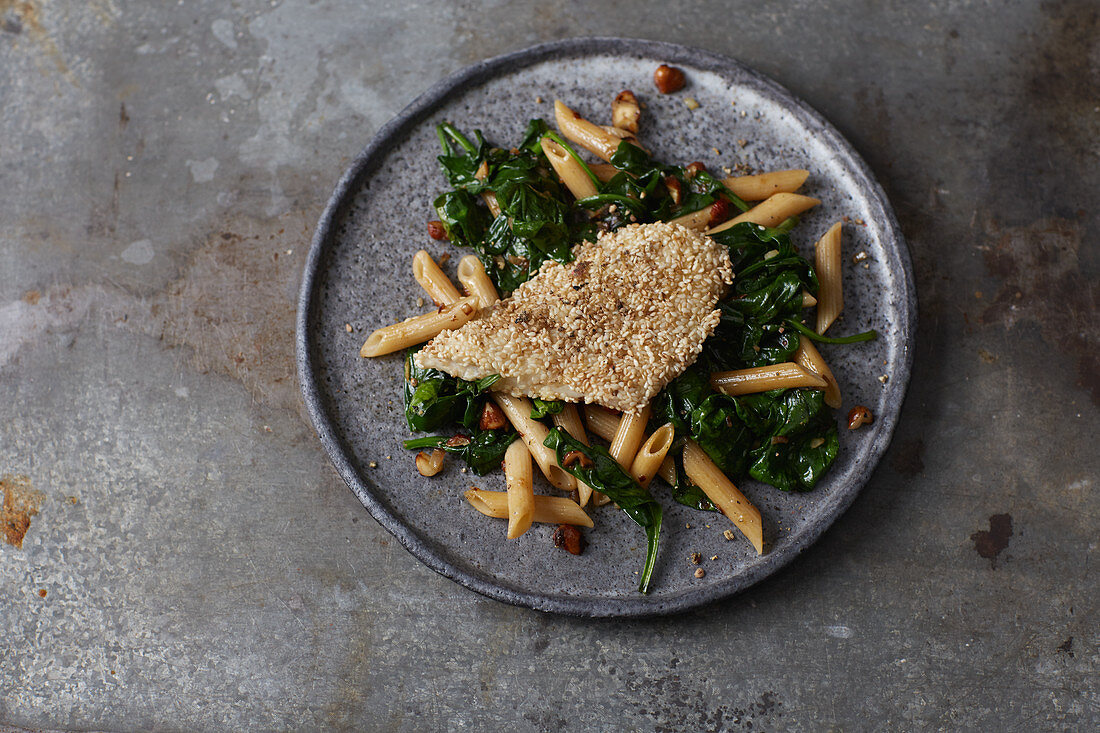 Sesame seed zander with spinach and pasta
