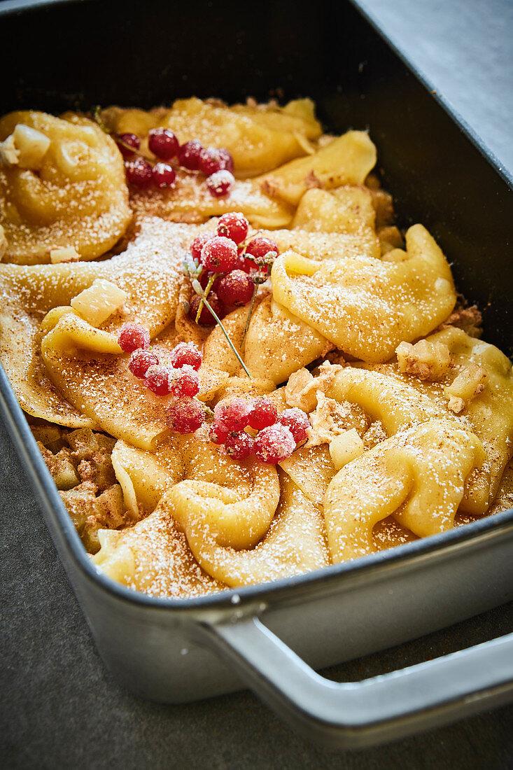 Rupfhauben (sweet, Bavarian pasta dough pastries) with braised apples