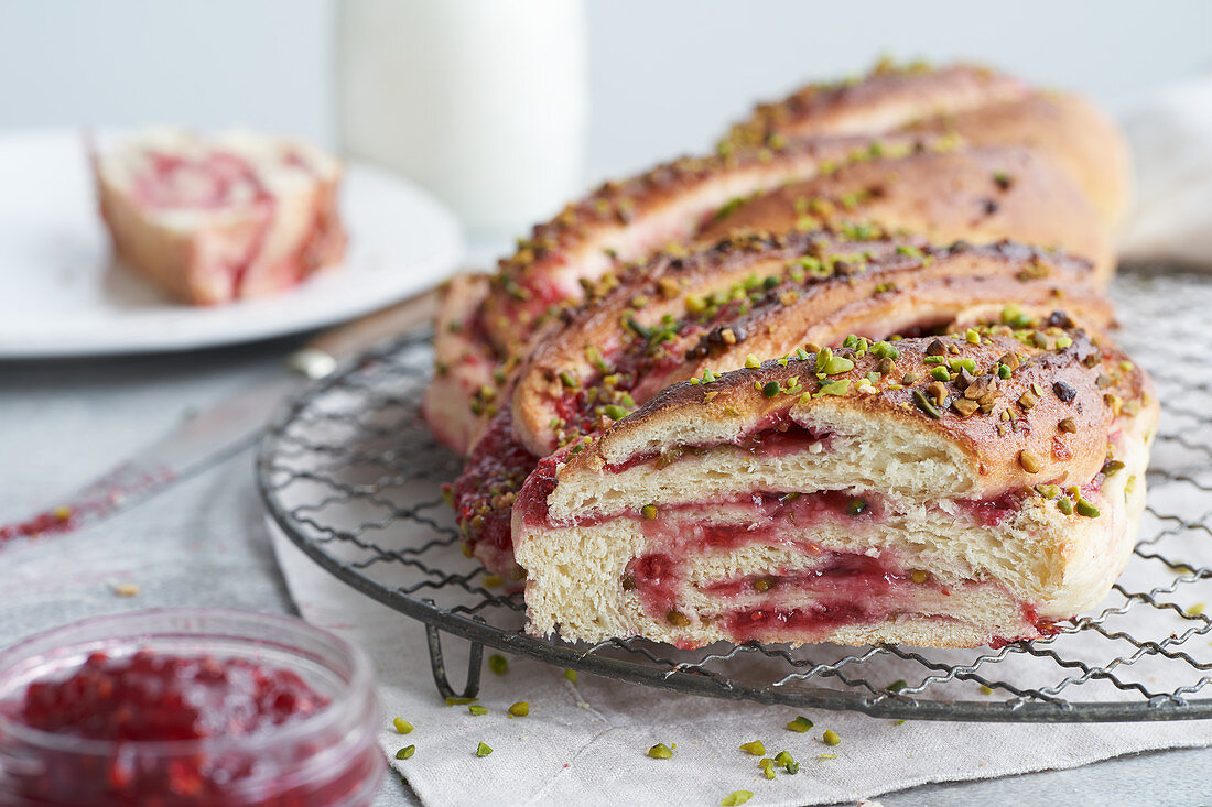 An Easter plait filled with jam and pistachio nuts