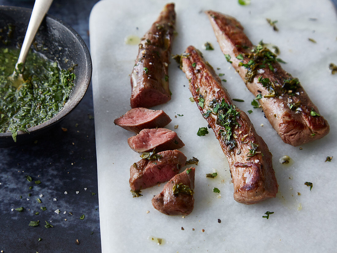 Sous vide lamb fillet with a herb sauce
