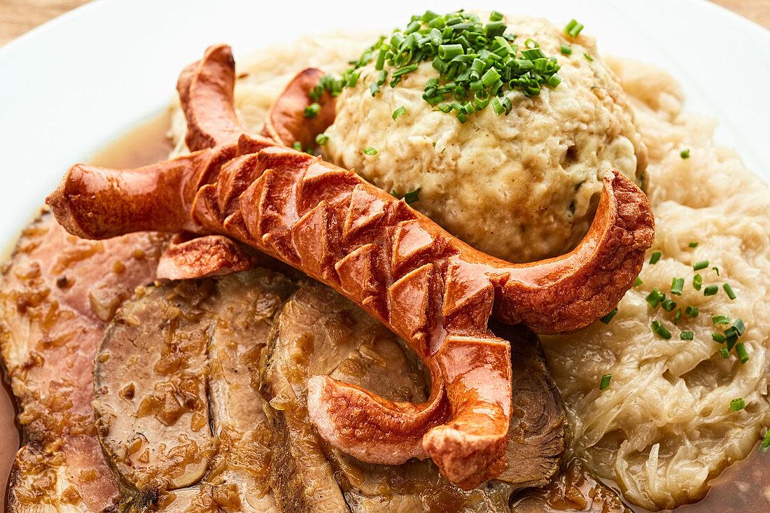 Bauernschmaus (roast pork, sausage, dumplings and sauerkraut, Austria)