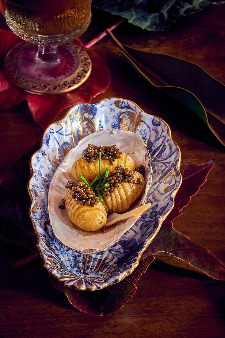 Hasselback potatoes with caviar