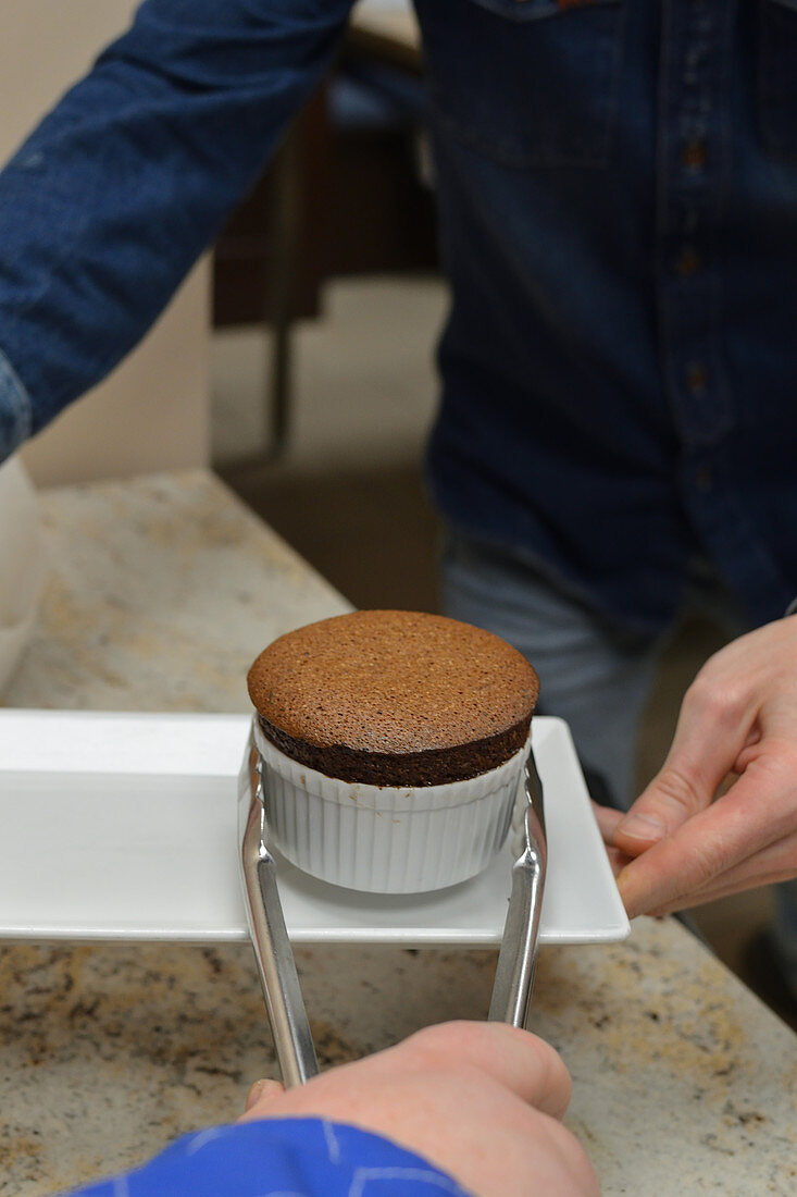 A chocolate souffle being served