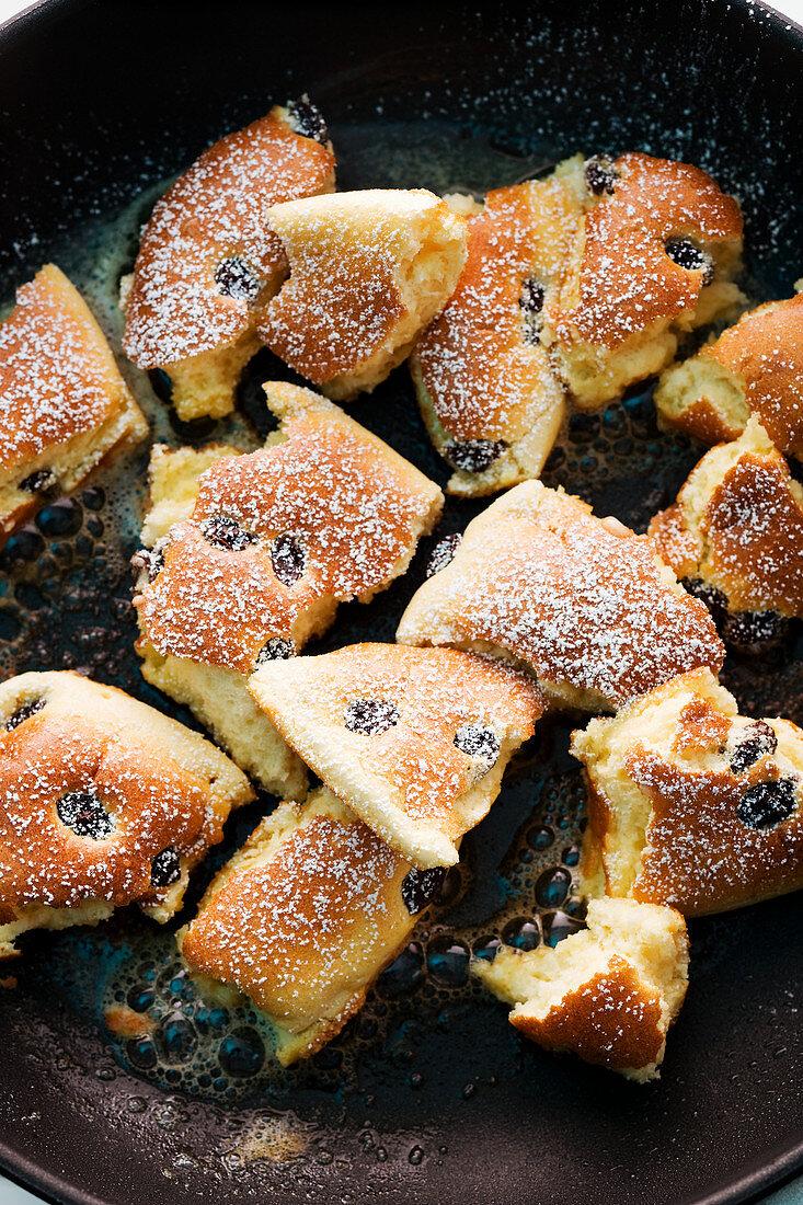 Shredded apple pancake with raisins and icing sugar