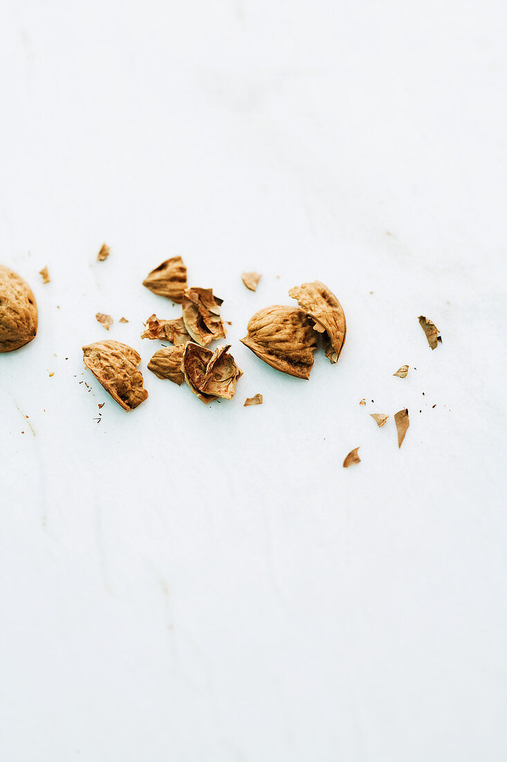 Walnut shells on a marble surface