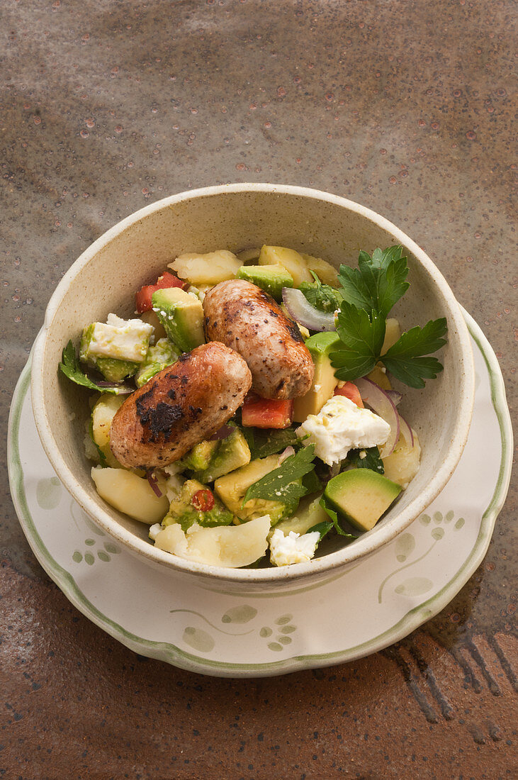 Avocado with spicy sausage and smashed herb potatoes