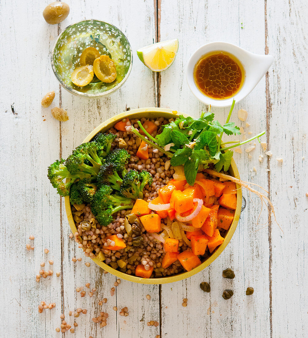 A buckwheat bowl with broccoli, olives, pumpkin and mint