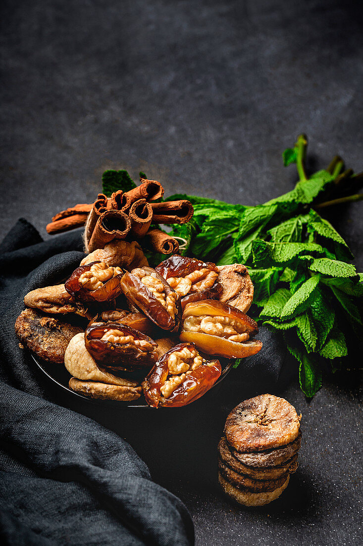 Dates fruits with and dried figs, mint and cinnamon muslim halal snack for Ramadan
