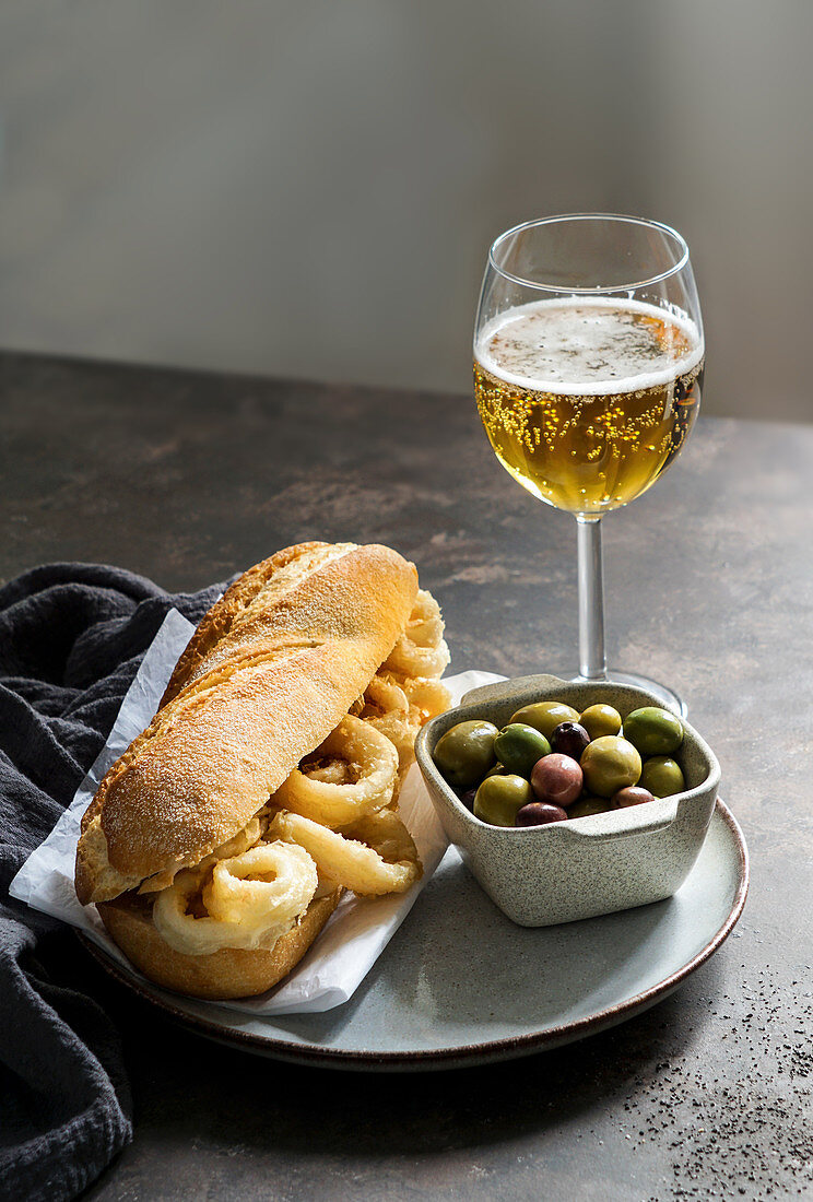 Bocadillo con calamares or squid sandwich with beer, very popular in Madrid spanish typical tapas