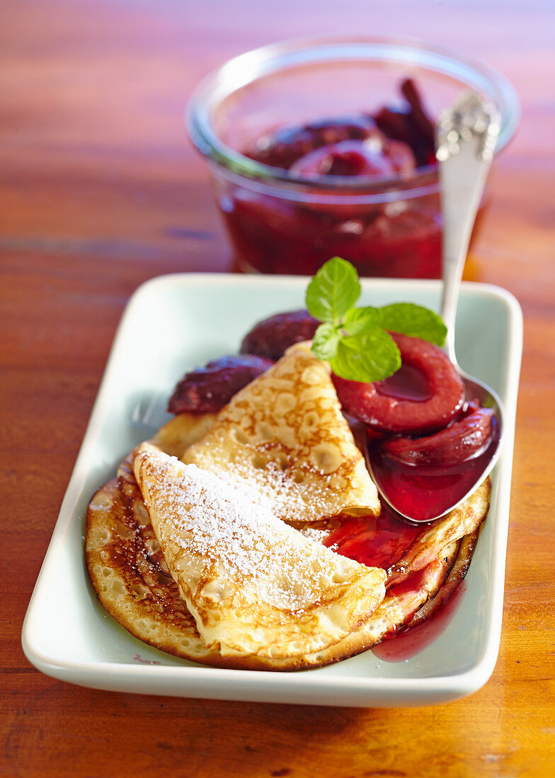 Pancakes with damson compote