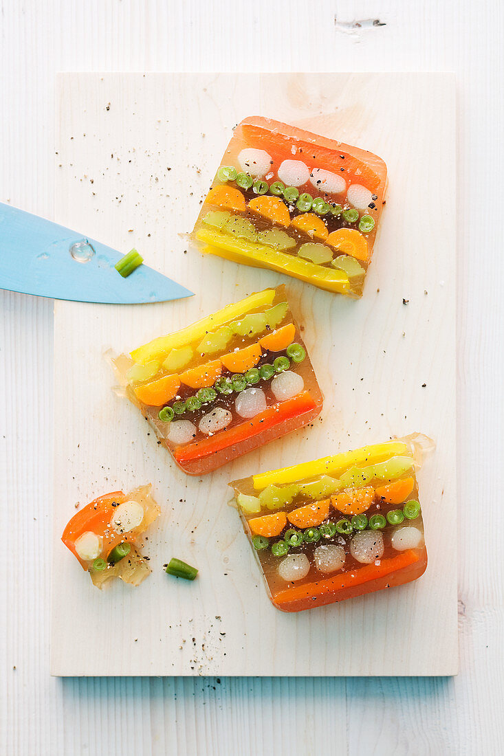 Aspic with beans, fennel, carrots, pepper and asparagus