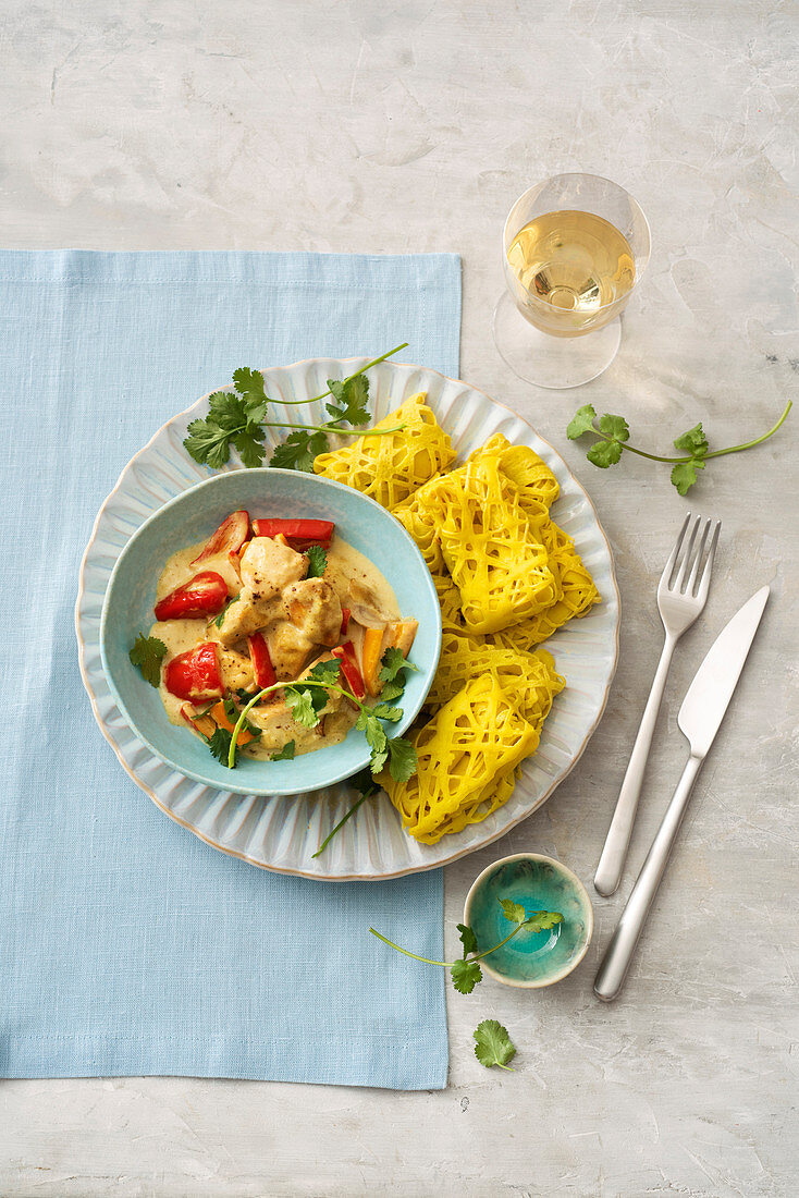 Roti jala with chicken curry and peppers