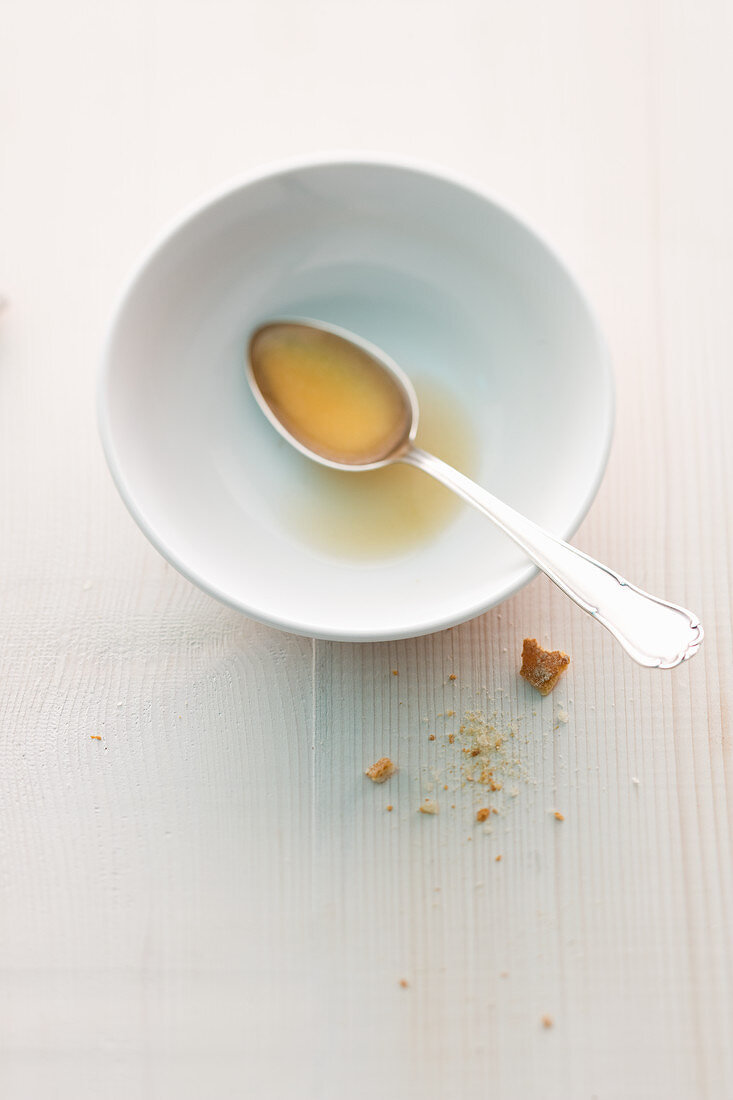 Remains of bouillon in a bowl with a spoon