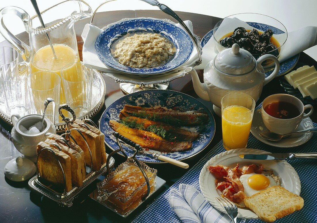 English breakfast with porridge, bacon & eggs, jam, tea