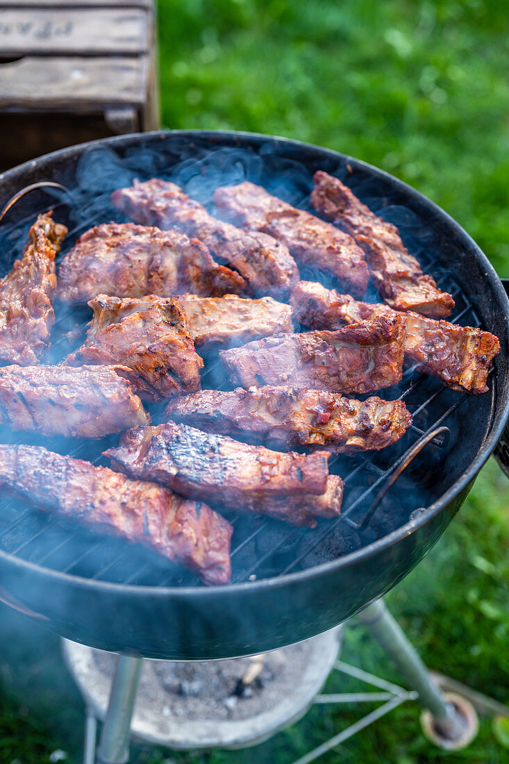 Marinated spare ribs being grilled