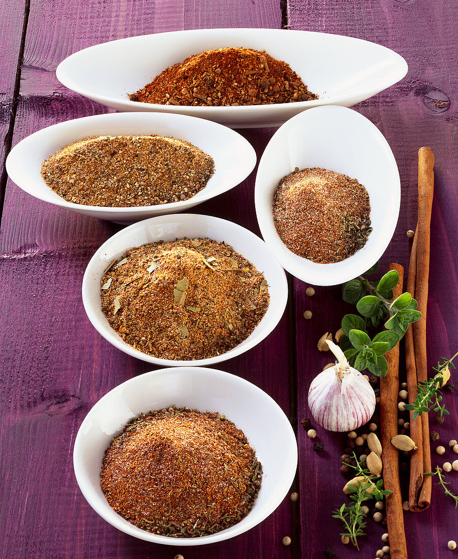A homemade spice mixtures: barbecuing spices, baharat, Cajun mix, Creole mix, Greek mix