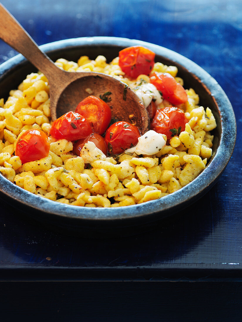 Sweetcorn and quark Spätzle (soft egg noodles from Swabia) with cherry tomatoes