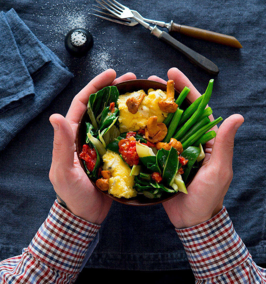 Polenta and chard bowl with beans, tomatoes and chanterelle mushrooms