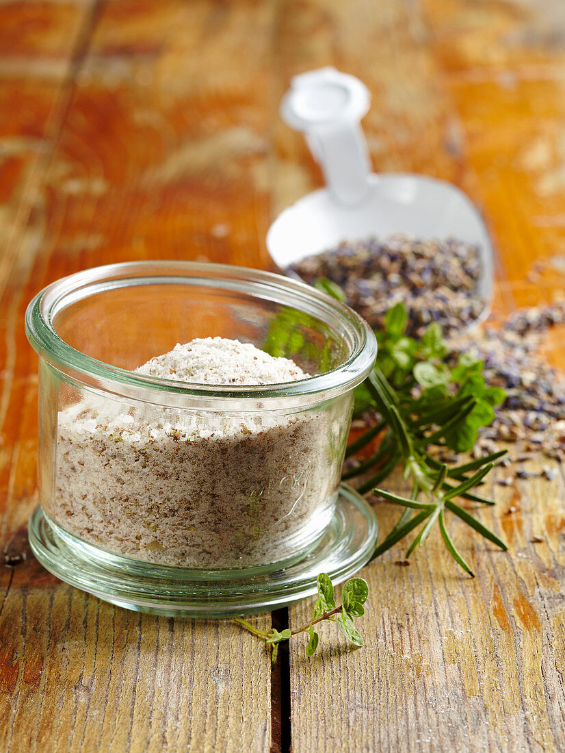 Spice mixture with bay leaves, rosemary, oregano, ajwain, lavender and salt