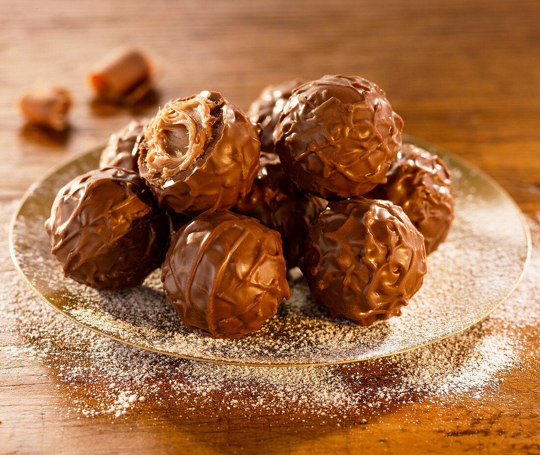 Milk chocolate truffles on a gold plate