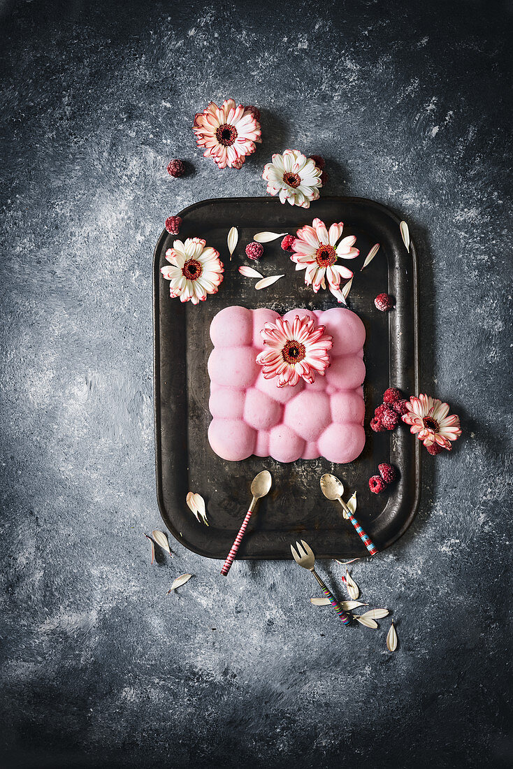 Raspberry pudding decorated with flowers