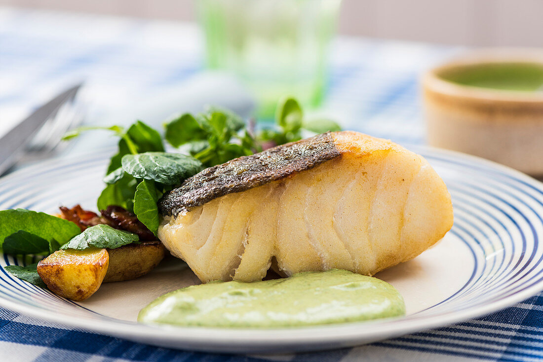 Fried fish with herb sauce and salad