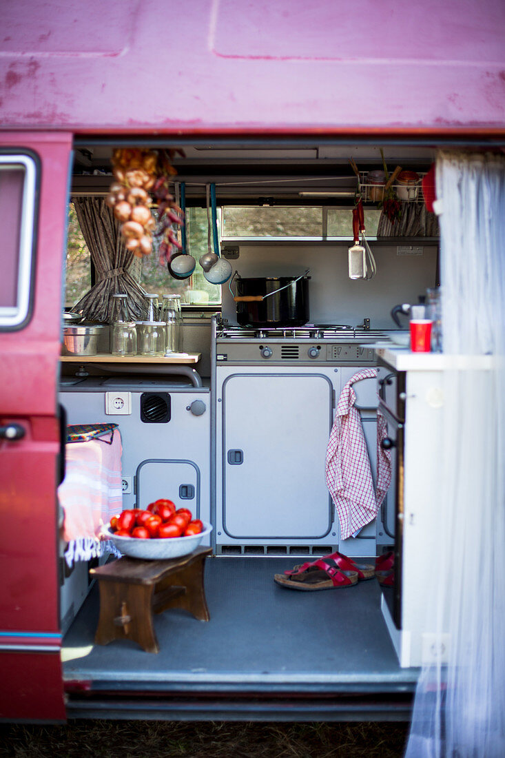 A kitchen in a camping bus