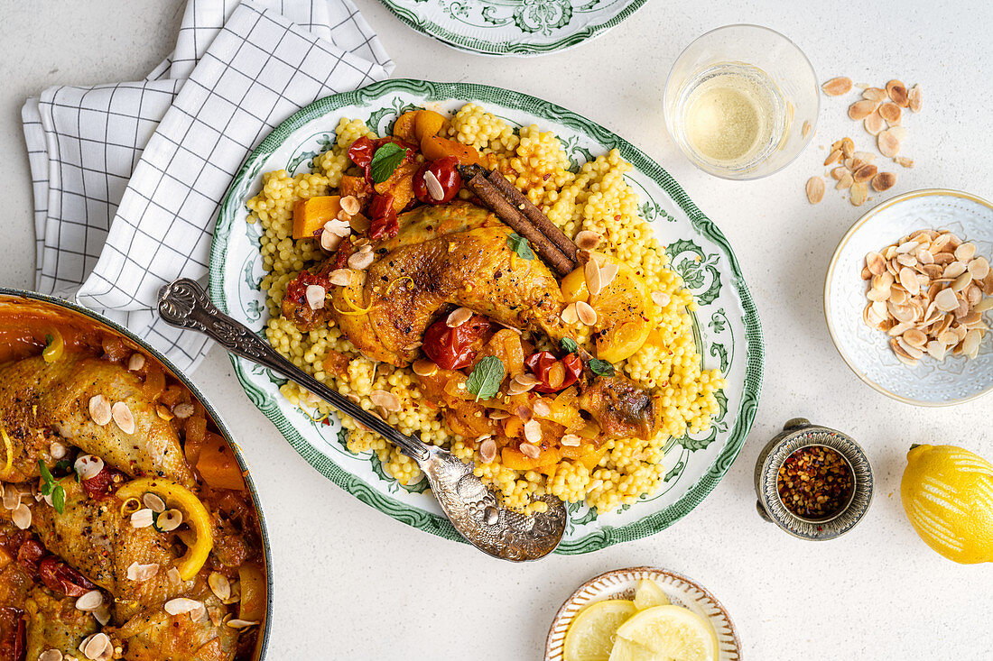 Moroccan chicken tagine with cast iron casserole on the side