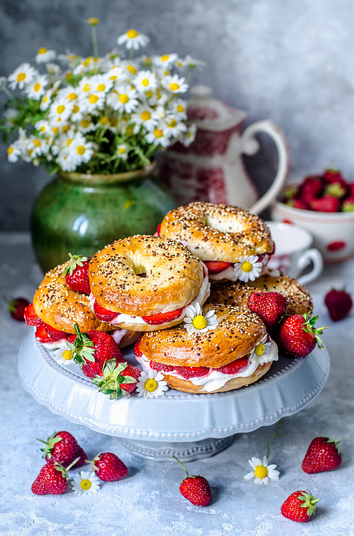 Bagels with whipped cream and strawberries