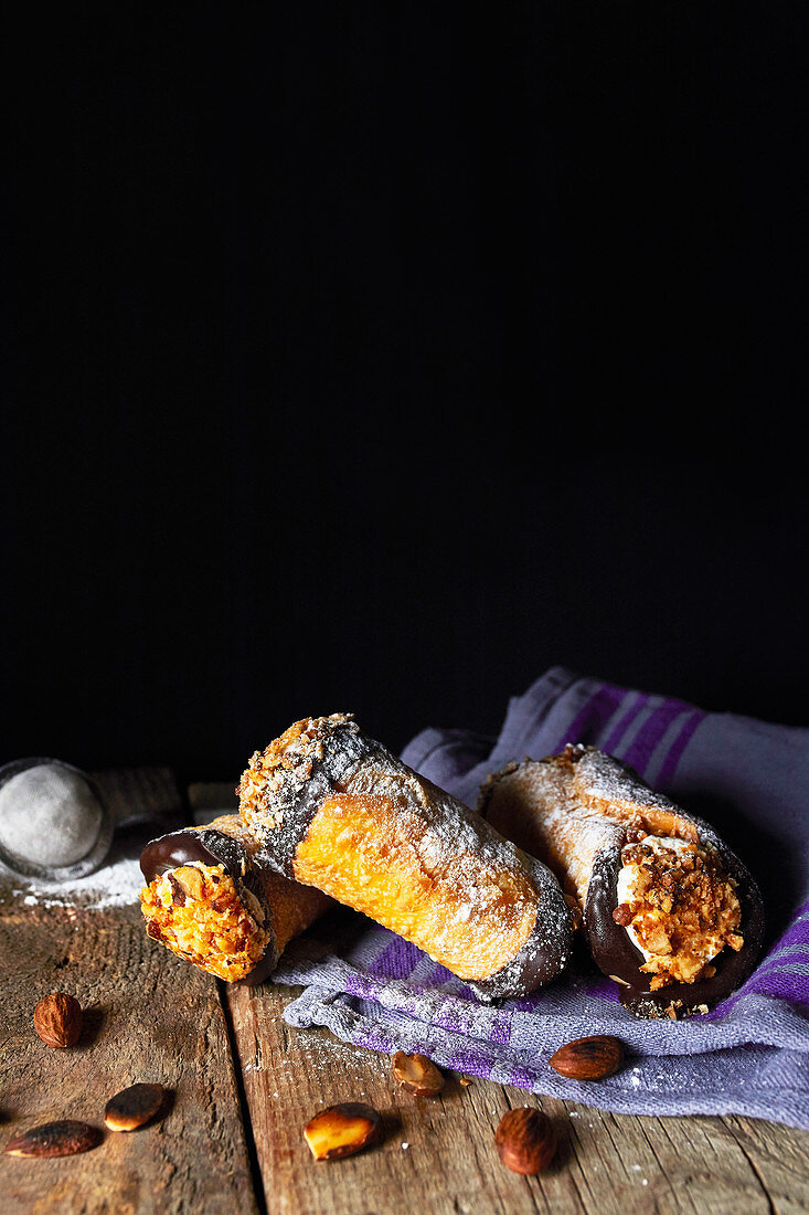 Sicilian cannoli with ricotta filling and chopped almonds (Italy)