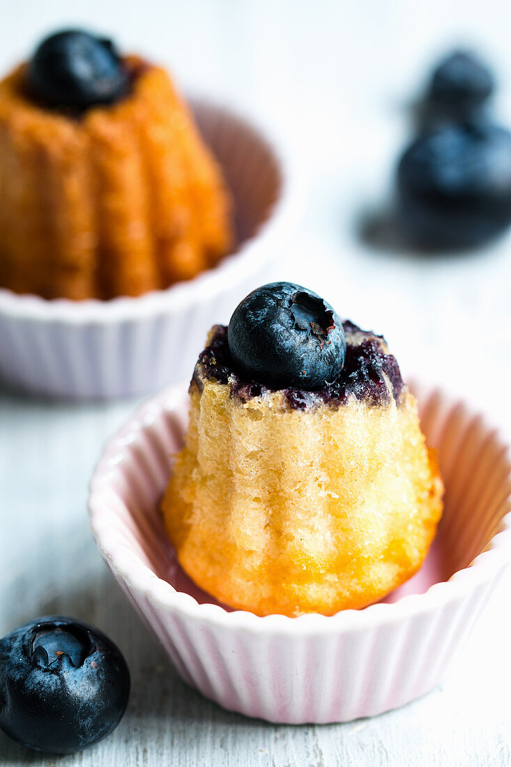 Canelés with blueberries