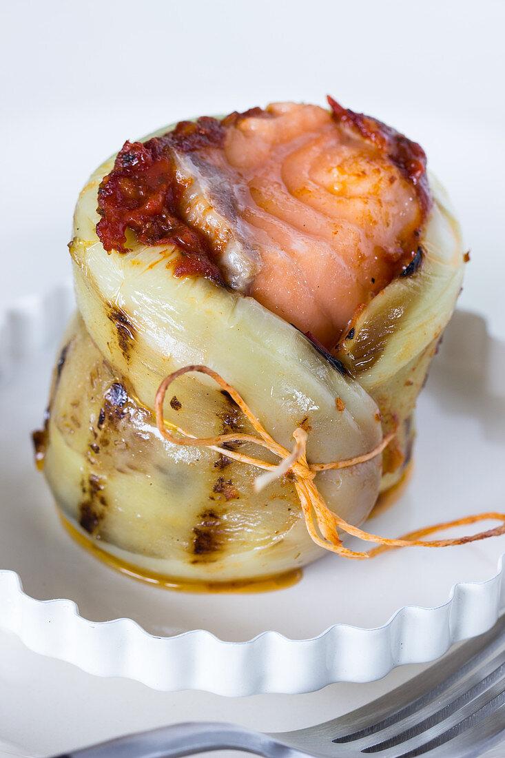 Eggplant rolls stuffed with salmon and tomato pesto