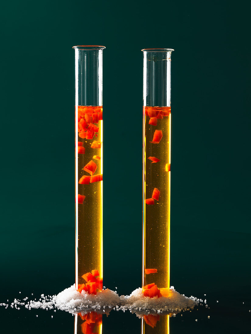 Saffron broth with floating pepper cubes (molecular gastronomy)