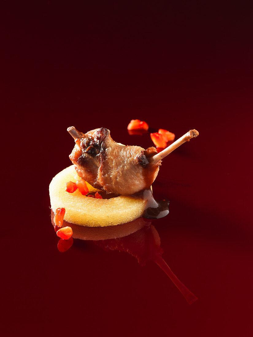 Infused quail leg on pineapple film (molecular gastronomy)