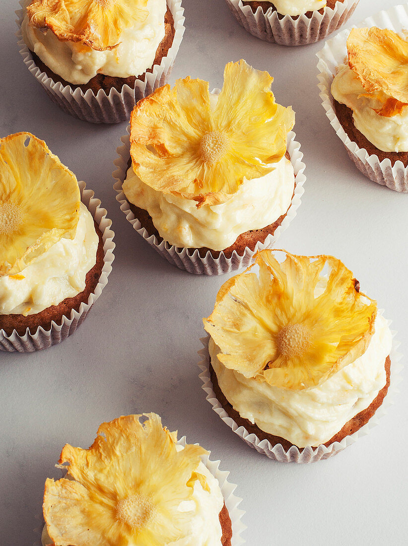Carrot cake muffins with pineapple flower decoration
