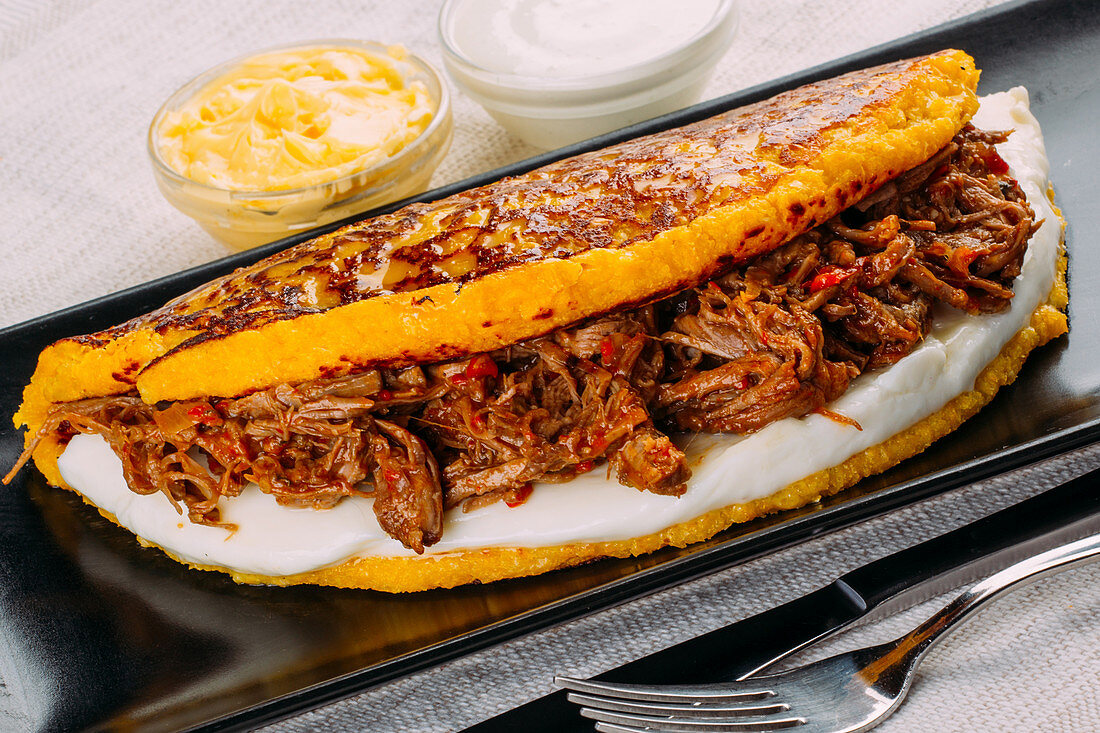 Cachapa (Typical Venezuelan dish made with corn and stuffed with white cheese and grilled meat)