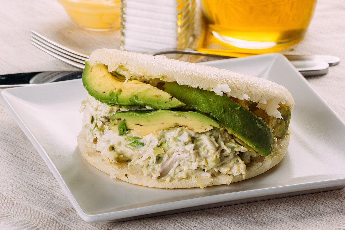 Famous Venezuelan arepa called queen pepeada, with avocado and chicken
