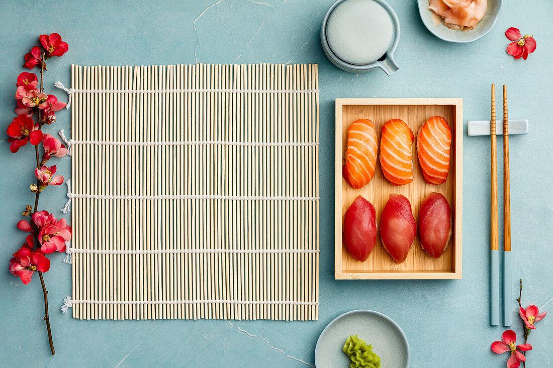 Nigiri sushi with salmon and tuna served on bamboo plate