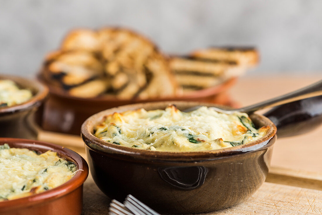Artichoke and spinach dip served with toasted bread