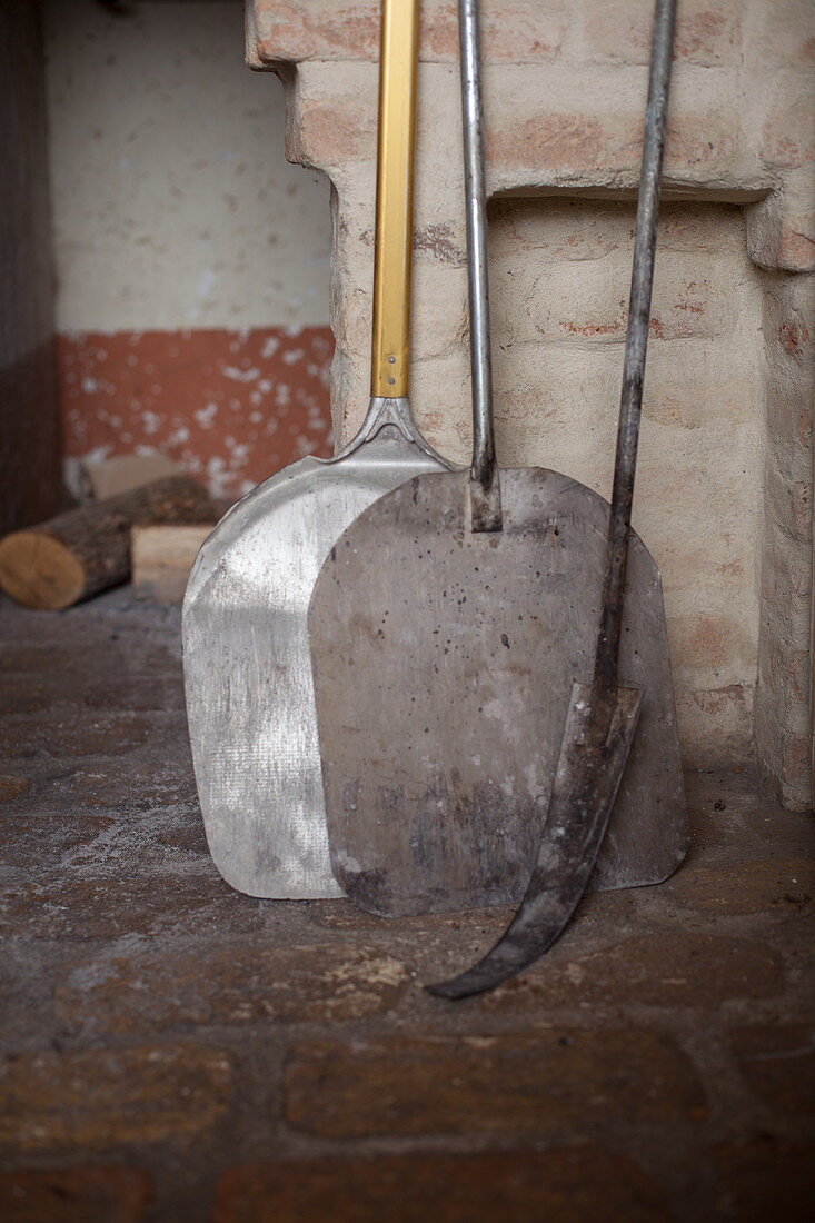 Bread shovels in front of an oven