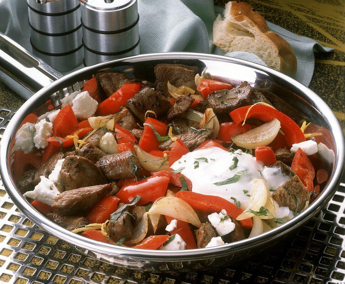 Pan-cooked pepper & lamb, sheep's cheese, onions & yogurt sauce