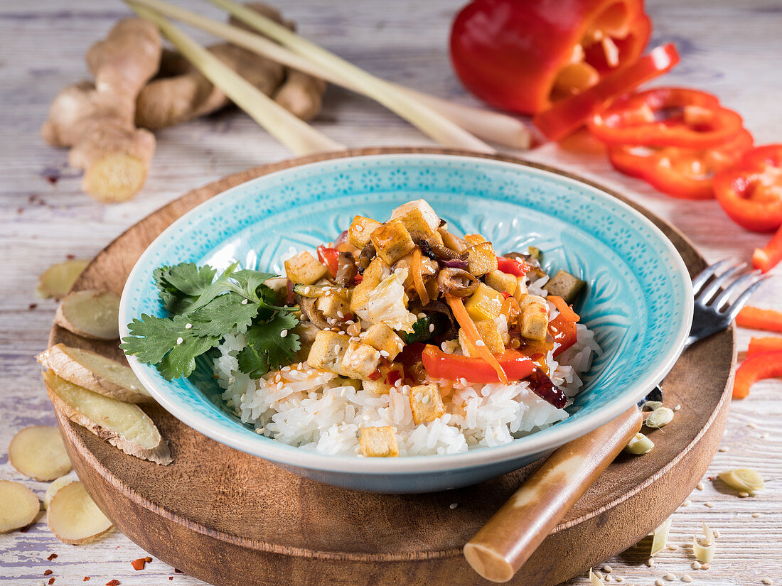 Wok vegetables with fried tofu, mushrooms, ginger and rice (Asia)